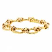 Bracelet maille contemporaine striée en or jaune 59.05grs